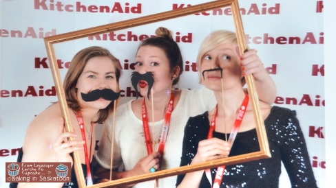 Andrea MacLeod, Kelly Brison and Kris are being silly in the KitchenAid photo booth.